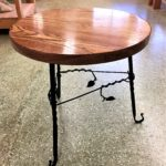 Wood side table with forged legs